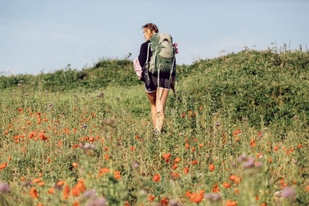 5_ Sophie Pavelle walking through poppy field by Jack Johns